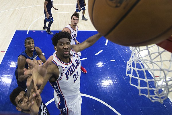 Philadelphia 76ers' Joel Embiid, right, of Cameroon, blocks out Minnesota Timberwolves' Karl-Anthony Towns, left, from the rebound during the first half of an NBA basketball game, Saturday, March 24, 2018, in Philadelphia. The 76ers won 120-108. (AP Photo/Chris Szagola)