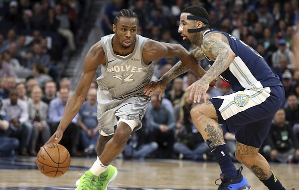 Minnesota Timberwolves' Andrew Wiggins, left, drives against Denver Nuggets' Wilson Chandler during the first half of an NBA basketball game Wednesday, April 11, 2018, in Minneapolis. (AP Photo/Jim Mone)