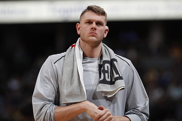 Minnesota Timberwolves center Cole Aldrich (45) in the second half of an NBA basketball game Thursday, April 5, 2018, in Denver. The Nuggets won 100-96. (AP Photo/David Zalubowski)