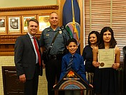 Gov. Jeff Colyer on Thursday presented Kansas Highway Patrol Technical Trooper Raul Carrillo with an Award for Valor in recognition of his actions Feb. 21 when he rescued a man from a burning truck following a rollover accident on the Kansas Turnpike in Butler County. Also pictured are Carrillo's son Esai, his wife Lydia, and daughter Aneesa.