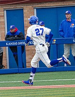 Kansas' Devin Foyle runs to first base after a base hit, Saturday, April 14, 2018, during a game against TCU at Hoglund Ballpark. The Jayhawks fell to TCU, 13-3.
