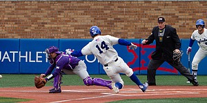 Kansas' Brett Vosik (14) slides past TCU's Zach Humphreys (10) to score as KU's Owen Taylor (4) watches, Saturday, April 14, 2018, at Hoglund Ballpark. The Jayhawks fell to TCU, 13-3.