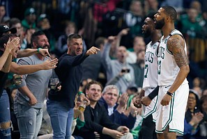Fans react after Boston Celtics' Marcus Morris (13) was fouled while shooting during the first quarter of Game 1 of an NBA basketball first-round playoff series against the Milwaukee Bucks, in Boston, Sunday, April 15, 2018. (AP Photo/Michael Dwyer)