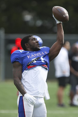 Kansas wide receiver Steven Sims Jr. (11) makes a one-hand catch during practice on Tuesday, April 17, 2018.