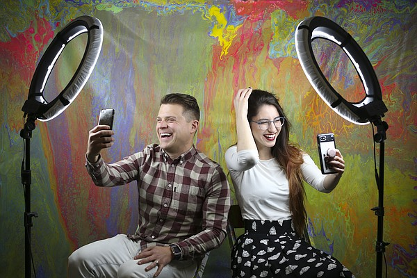 The Selfie Boutique founder Alex Altomare, left, and Braydie Elliott, director of operations, have fun during a selfie portrait session on Thursday, April 19, 2018 at their business, 2429 Iowa St. The boutique, which offers dozens of selfie scenarios with different backdrops for visitors to explore, will be at the location until May 14.