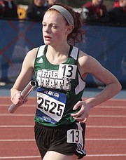 Free State's Emma Hertig runs in the girls 4x1,600-meter relay at the Kansas Relays on Friday at Rock Chalk Park.
