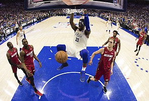 In this photo taken with a fisheye lens, Philadelphia 76ers' Joel Embiid, of Cameroon, dunks the ball during the first half in Game 5 of a first-round NBA basketball playoff series against the Miami Heat, Tuesday, April 24, 2018, in Philadelphia. The 76ers won 104-91. (AP Photo/Chris Szagola)