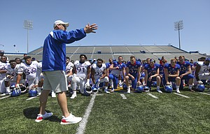 Kansas head coach David Beaty talks with his players following an open practice on Saturday, April 28, 2018 at Memorial Stadium.