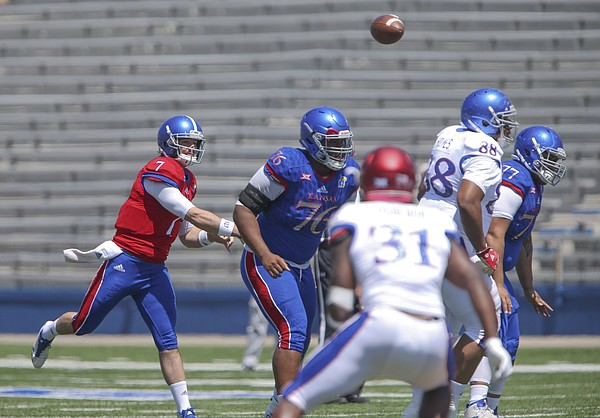 Kansas quarterback Peyton Bender (7) throws during an open practice on Saturday, April 28, 2018 at Memorial Stadium.