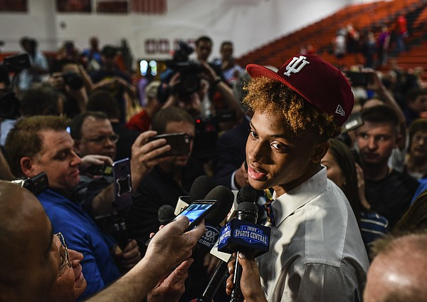Romeo Langford discusses his decision to continue his basketball career at Indiana University following his college announcement ceremony at New Albany High School, Monday, April 30, 2018, in New Albany, Ind.