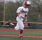 Lawrence High junior Payton Cummins runs home during the Lions' 7-6 loss to Shawnee Mission Northwest on Tuesday at LHS.