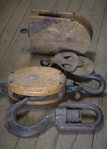 Among some of the antique items recently found at Ernst & Son Hardware is a group of pulleys and hooks, pictured Wednesday, May 2, 2018, at the store.