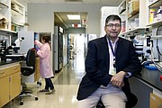 In this May 1, 2018 photo, Dr. Michael Polydefkis, a neurologist at John Hopkins University, poses for a photograph in a lab in Baltimore. (AP Photo/Patrick Semansky)