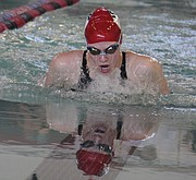 Lawrence High's Marian Frick swims to a first-place finish in the 100-yard breaststroke during the finals of the Sunflower League swim and dive meet on Saturday at LHS. Frick broke the league record in the event in Friday's prelims.