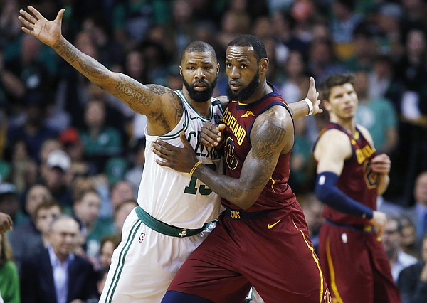 Cleveland Cavaliers forward LeBron James, right, fights for position against Boston Celtics forward Marcus Morris (13) during the third quarter of Game 1 of the NBA basketball Eastern Conference Finals, Sunday, May 13, 2018, in Boston. (AP Photo/Michael Dwyer)
