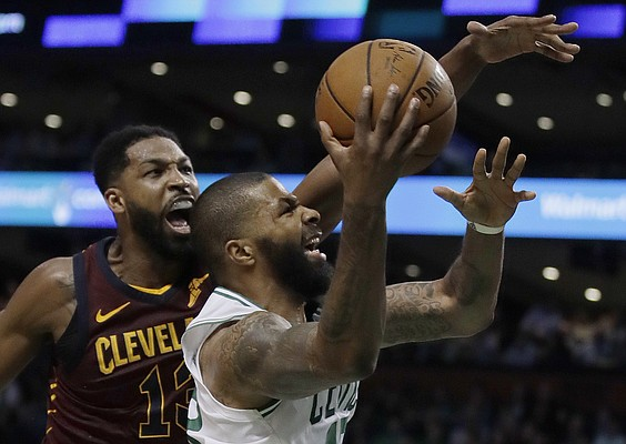Boston Celtics forward Marcus Morris drives to the basket against Cleveland Cavaliers center Tristan Thompson, left, during the second half in Game 2 of the NBA basketball Eastern Conference finals Tuesday, May 15, 2018, in Boston. (AP Photo/Charles Krupa)