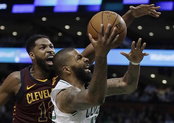 1e3ea37f4078 Boston Celtics forward Marcus Morris drives to the basket against Cleveland  Cavaliers center Tristan Thompson
