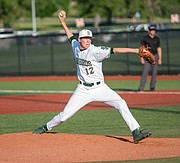 Free State pitcher David Stuart (12) winds up for the pitch. Free State outscored Wichita Northwest, 4-2, at FSHS on Wednesday, May 16, 2018 at FSHS. Free State will advance to State.