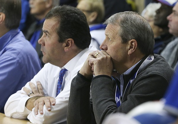 In this file photo from Nov. 8, 2017, University of Kansas Chancellor Douglas Girod, right, and KU athletic director Sheahon Zenger watch the action from the sideline at a KU volleyball game.