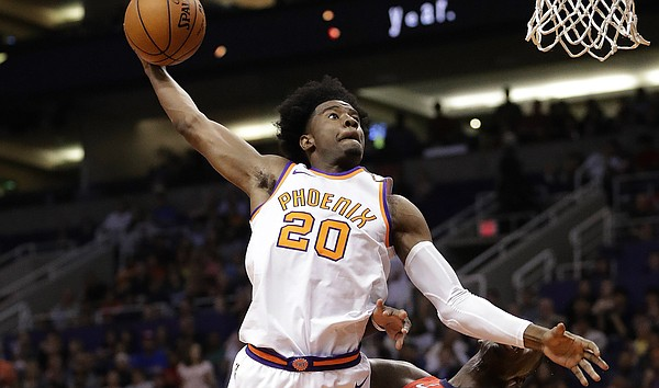 Phoenix Suns guard Josh Jackson (20) dunks over New Orleans Pelicans forward Cheick Diallo (13) during the second half of an NBA basketball game Friday, April 6, 2018, in Phoenix. (AP Photo/Matt York)