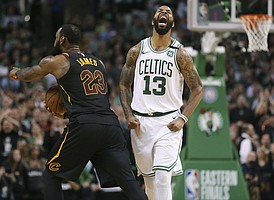 Boston Celtics forward Marcus Morris, right, and Cleveland Cavaliers forward LeBron James react after James didn't cross the half court line in the allotted time during the second half in Game 7 of the NBA basketball Eastern Conference finals, Sunday, May 27, 2018, in Boston. (AP Photo/Elise Amendola)