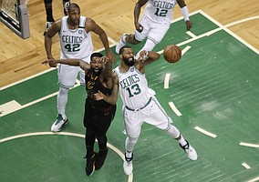 Cleveland Cavaliers center Tristan Thompson, front left, and Boston Celtics forward Marcus Morris, right, fight for the ball during the first half in Game 7 of the NBA basketball Eastern Conference finals, Sunday, May 27, 2018, in Boston. (AP Photo/Charles Krupa)