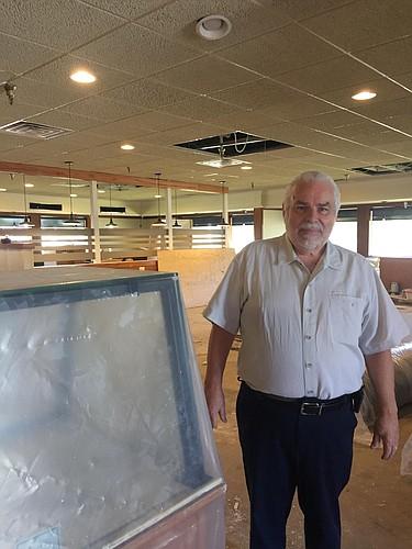 Owner Dan Esmond stands inside the Perkins restaurant under renovation at 23rd and Ousdahl.