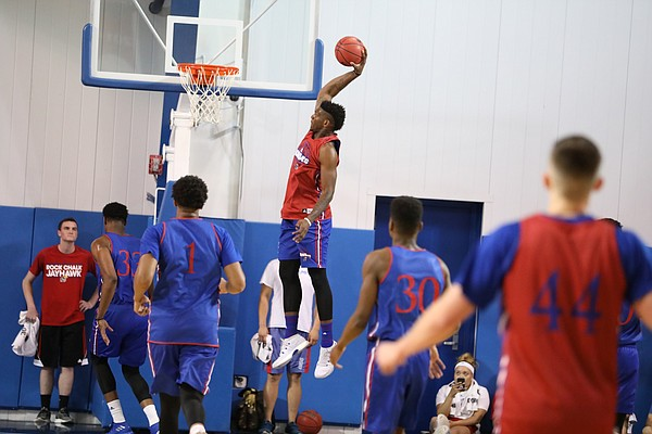 Red Team forward Silvio De Sousa (22) soars in for a dunk during a scrimmage on Tuesday, June 5, 2018, at the Horejsi Athletic Center.