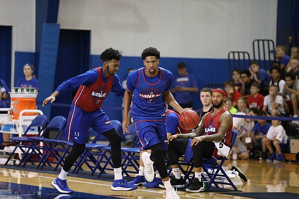 KU forward Dedric Lawson (1) makes a move to get by his brother, K.J. Lawson during the Jayhawks camp scrimmage on Tuesday, June 5, 2018, at Horejsi Center.