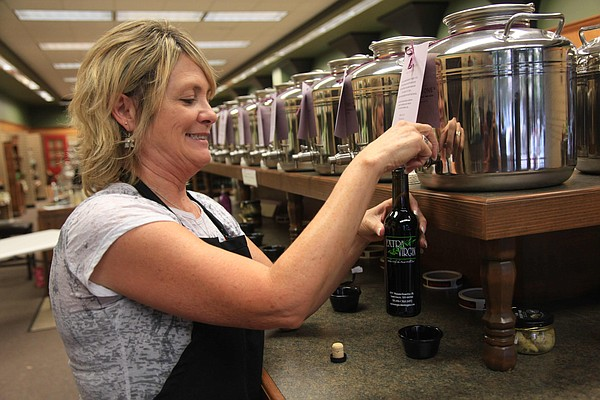 Deborah Briggs, owner of Extra Virgin at 937 Massachusetts St., is pictured in this file photo from July 2012.