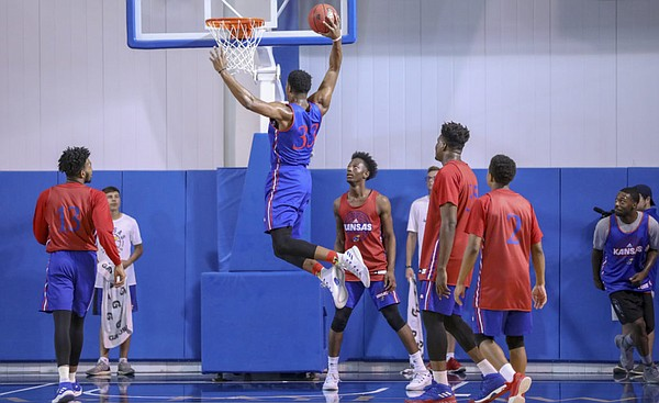 Blue Team center David McCormack comes in for a dunk during a scrimmage on Wednesday, June 13, 2018, at the Horejsi Family Athletics Center.