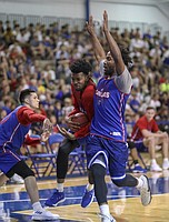 Red Team guard K.J. Lawson  is defended by Blue Team guard Elijah Elliott (left) and former KU guard Wayne Selden Jr. during a scrimmage on Wednesday, June 13, 2018, at the Horejsi Family Athletics Center.