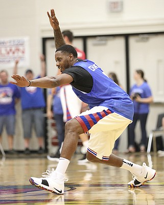 Blue Team guard Mario Chalmers celebrates after hitting a three to end the half during the Rock Chalk Roundball Classic on Thursday, June 14, 2018 at Free State High School.