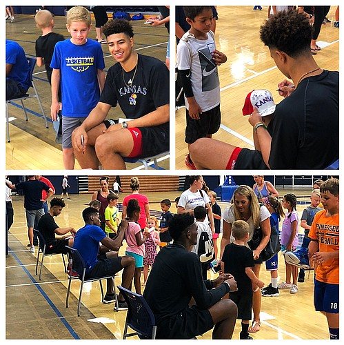 KU freshman Quentin Grimes, along with teammates Ochai Agbaji, Silvio De Sousa and K.J. Lawson (not pictured), spent part of their day Tuesday working Washburn Basketball camp and visiting with young fans in Topeka.