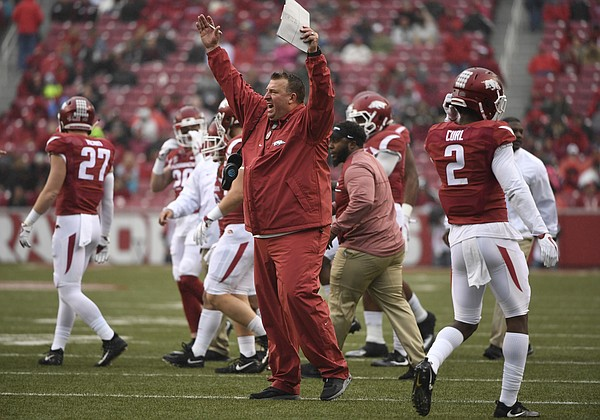 In this Nov. 18, 2017, file photo, Arkansas coach Bret Bielema talks with the officials during the first half of an NCAA college football game against Mississippi State in Fayetteville, Ark. The Razorbacks are dealing with their own dose of turmoil at the moment. Last week's 28-21 loss to No. 16 Mississippi State guaranteed Arkansas' third losing season in the last six years, and it came days after the school fired former athletic director Jeff Long. There's likely more uncertainty ahead in the days following Friday's game against Missouri for Arkansas--in particular for fifth-year coach Bielema. (AP Photo/Michael Woods, File)