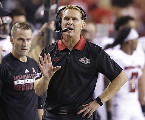 FILE — Arkansas State coach Blake Anderson talks on his headset during the second half of an NCAA college football game against Nebraska in Lincoln, Neb., Saturday, Sept. 2, 2017. Nebraska won 43-36. (AP Photo/Nati Harnik)