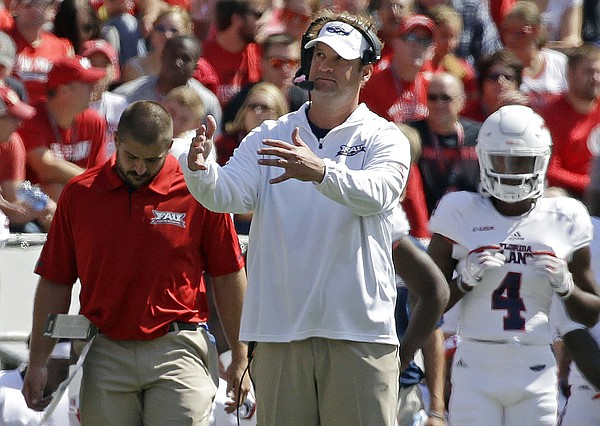 In this Sept. 9, 2017, file photo, Florida Atlantic head coach Lane Kiffin gestures from the sidelines during an NCAA college football game against Wisconsin, in Madison, Wis. Kiffin never definitively said what his expectation was for his first season at Florida Atlantic, though one thing is absolutely certain. He did not expect this.FAU is already 7-3, with six wins in a row. (AP Photo/Aaron Gash, File