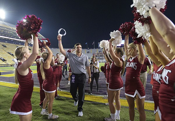 Troy head coach Neal Brown celebrates his team's 24-21 victory over LSU in an NCAA college football game in Baton Rouge, La., Saturday, Sept. 30, 2017. (AP Photo/Matthew Hinton)
