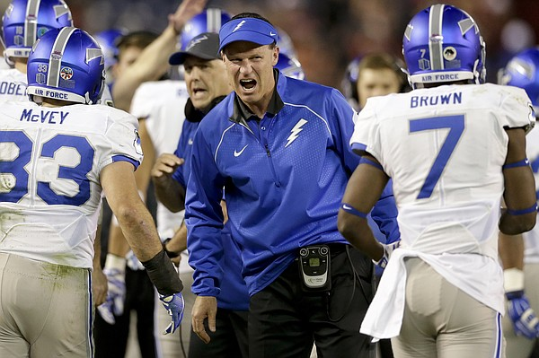 Air Force head coach Troy Calhoun, center, greets his offense during the first half of the NCAA Mountain West Championship football game against San Diego State Saturday, Dec. 5, 2015, in San Diego. (AP Photo/Gregory Bull)