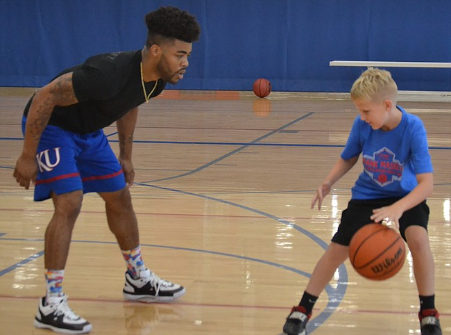 Former Kansas guard Frank Mason defends a participant during his youth basketball camp at Sports Pavilion Lawrence on Wednesday. Mason, who plays for the Sacramento Kings, will hosts three different youth camps this week in Kansas.