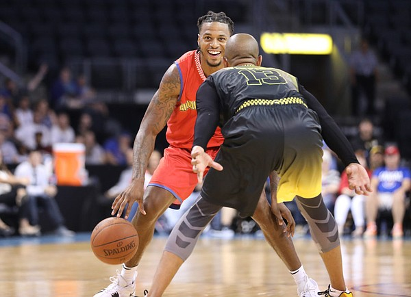 Kansas Alumni guard Brandon Rush looks to break down Missouri Alumni guard Julian Winfield during the second half of a charity scrimmage on Saturday, July 28, 2018 at Silverstein Eye Centers Arena in Independence, Mo.