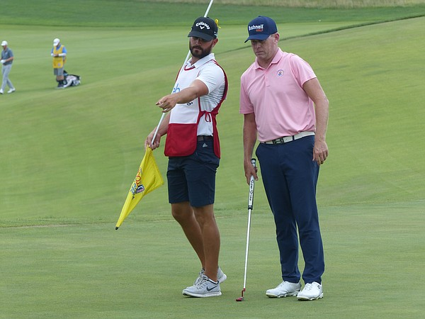 Caddie Chevy Hartzog has been pointing the way for Chris Thompson during his strong finish to the Web.com season. Thompson heads into the final round of the KC Golf Classic tied for third. (Photo by Tom Keegan)