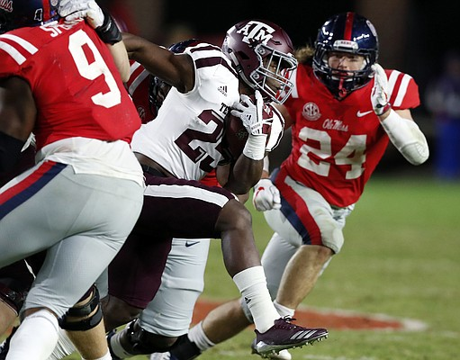 Kendall Bussey, shown in this Nov. 18, 2017 photo running for Texas A&M against Ole Miss, has transferred to Nicholls State and will play against Kansas at David Booth Memorial Stadium in Sept. 1 season opener. (AP Photo/Rogelio V. Solis)