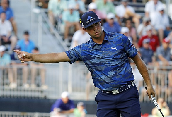 Gary Woodland gestures after putting on the 18th green during the third round of the PGA Championship golf tournament at Bellerive Country Club, Saturday, Aug. 11, 2018, in St. Louis. (AP Photo/Brynn Anderson)