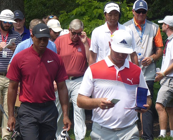 Gary Woodland and Tiger Woods head toward fourth tee box at Bellerive in the 100th PGA Championship as Missouri Gov. tugs at his sunglasses. (Photo by Tom Keegan)