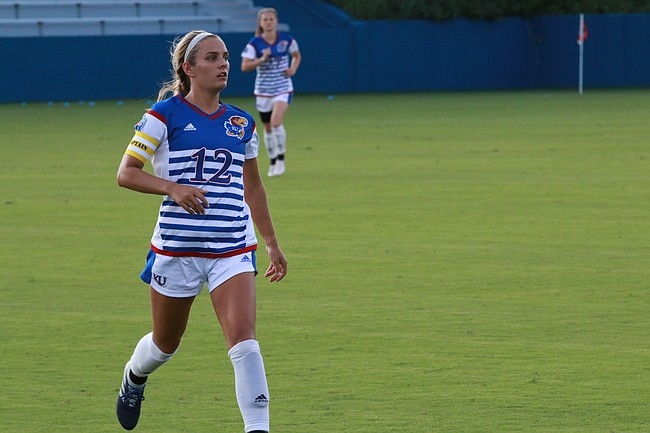 Junior forward Katie McClure chases down a pass in the first half. Kansas upset No. 18 Pepperdine, 1-0, in its home opener on Friday, Aug. 18, 2018.