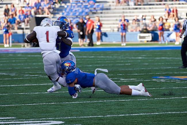 Kansas safeties Bryce Torneden (1) and Mike Lee (11) tackle Nicholls State running back Dontrell Taylor (1) during the first half on Saturday, Sept. 1, 2018 at Memorial Stadium.