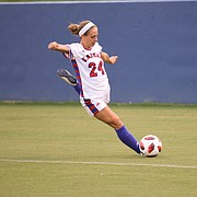 Defender Elise Reina sends a ball in play Sunday at Rock Chalk Park. Reina scored the lone goal in Kansas' win over No. 25 Butler.
