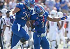 Kansas linebacker Joe Dineen Jr. (29) and Kansas safety Bryce Torneden (1) celebrate a defensive stop during the first quarter on Saturday, Sept. 15, 2018 at Memorial Stadium.