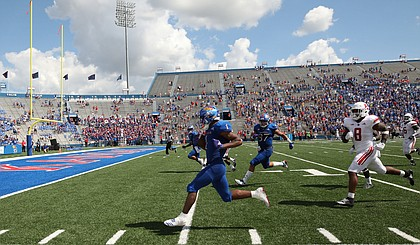 Kansas running back Pooka Williams runs in a touchdown during the fourth quarter on Saturday, Sept. 15, 2018 at Memorial Stadium.